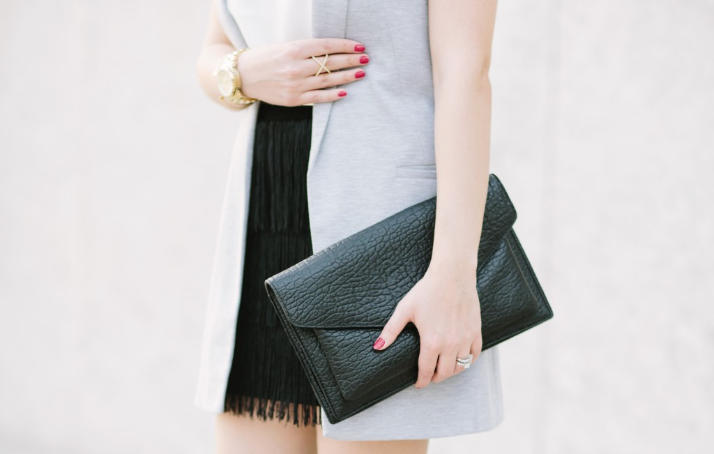 Grey Vest and Black Clutch